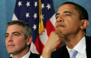Actor George Clooney (L) and Sen. Barack Obama (R) (D-IL) listen to a question at The National Press Club Newsmaker's Program April 27, 2006 in Washington, DC. Clooney joined Sen. Sam Brownback and Sen. Barack Obama in discussing the current situation in the Darfur region of Sudan and also held a news conference regarding Clooney's recent visit to the Darfur.  (Photo by Win McNamee/Getty Images)