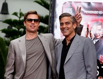 Actors Brad Pitt and George Clooney (R), stars of the film Ocean's 13, pose for photos during their hand and footprints ceremony at Grauman's Chinese Theatre on June 5, 2007 in Hollywood, California.  (Photo by Kevin Winter/Getty Images)