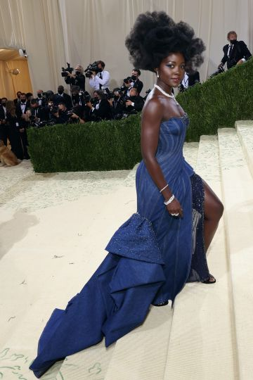 """NEW YORK, NEW YORK - SEPTEMBER 13: Lupita Nyong'o attends the 2021 Met Gala benefit """"In America: A Lexicon of Fashion"""" at Metropolitan Museum of Art on September 13, 2021 in New York City. (Photo by Taylor Hill/WireImage)"""