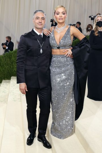 """NEW YORK, NEW YORK - SEPTEMBER 13: Taika Waititi and Rita Ora attend the 2021 Met Gala benefit """"In America: A Lexicon of Fashion"""" at Metropolitan Museum of Art on September 13, 2021 in New York City. (Photo by Taylor Hill/WireImage)"""