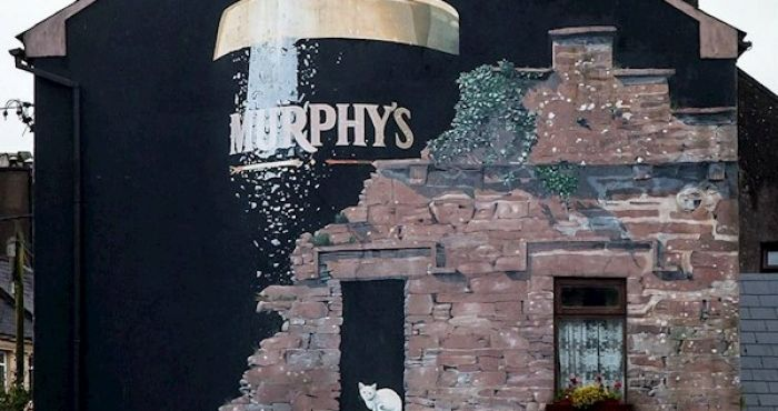 Iconic Murphy's mural in Cork is painted over after falling foul of alcohol advertising law | The Irish Post