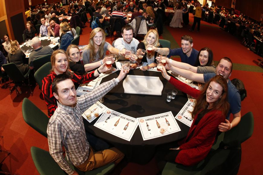 Group Photo Of The Guinness World Records Participants Raising A Glass Of Their Beer Samples 4