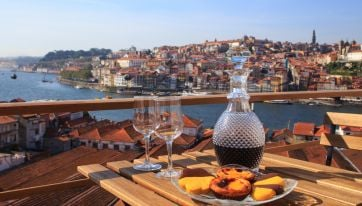 Six Rooftop Bars In Porto Where You'll Find The Most Stunning Views In The City