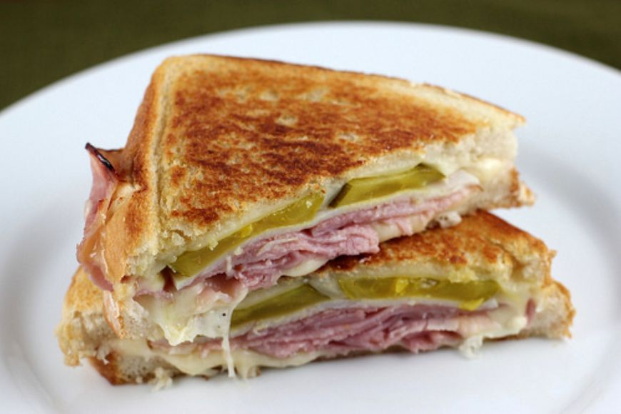 hot-sandwich-filled-with-cheese-ham-mayo-and-pickles