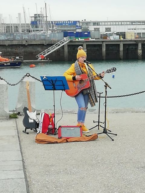 Molli donated her busking money to helping the homeless.