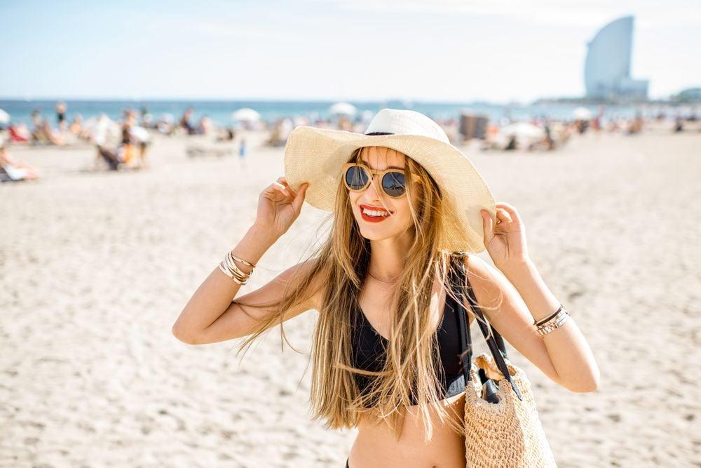 Woman on a sunny holiday on Barcelona Beach