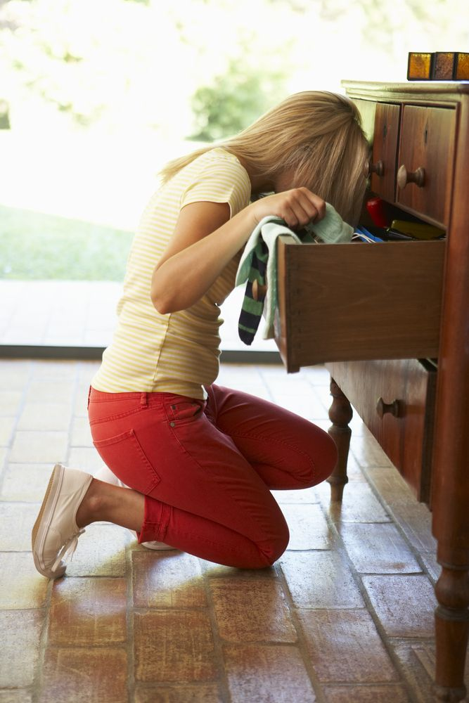 woman looking for something at home