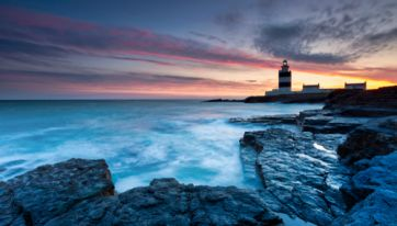 Watch The Sunset From Ireland's Oldest Lighthouse With Prosecco And Canapés On This One Of A Kind Tour