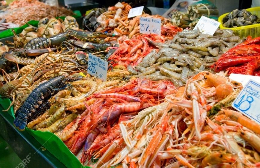 3149993-Great-quantity-of-fresh-seafood-on-fish-market-in-Barcelona-Spain-Stock-Photo