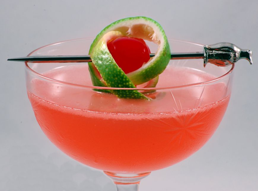 Pink Lady With A Twist Of Lime In A Cocktail Glass
