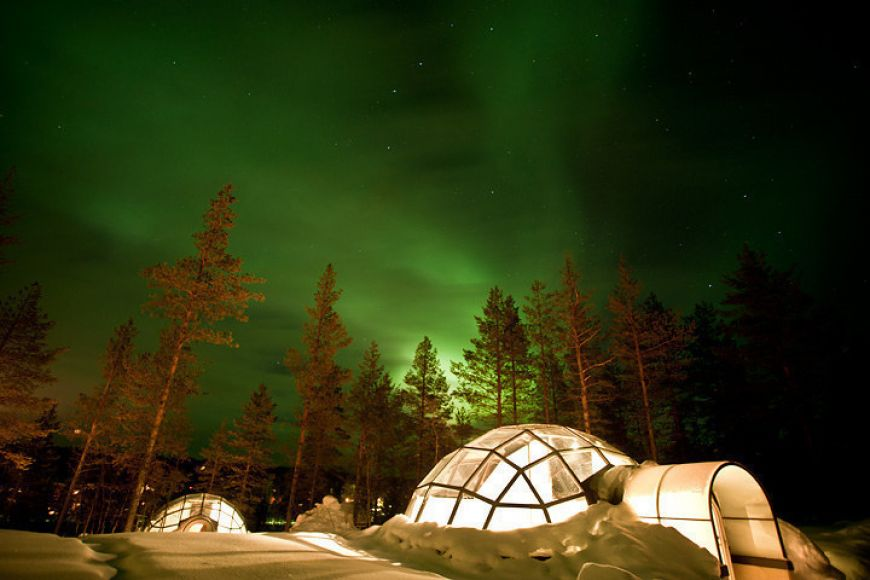 Huddled-inside-a-glass-igloo-in-Finland