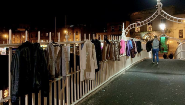 Dublin's Ha'penny Bridge adorned with donated coats for the homeless