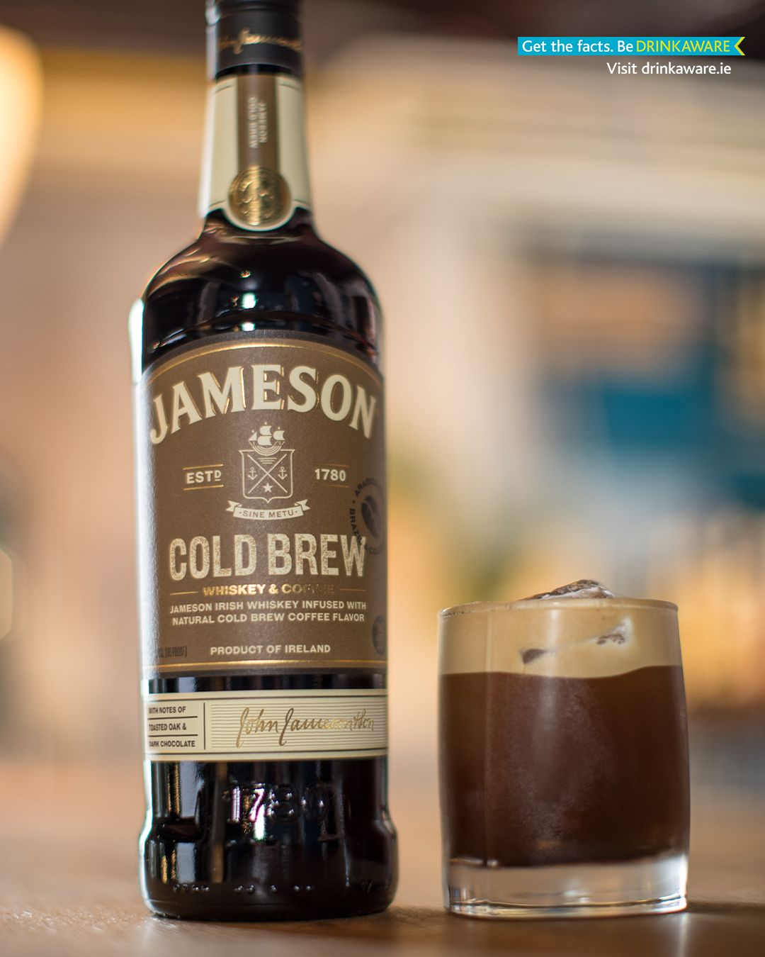 Cold Brew-tini in a glass beside Jameson bottle