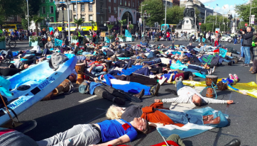 PICS: Extinction Rebellion Staged A 'Die-In' On O'Connell Bridge This Afternoon