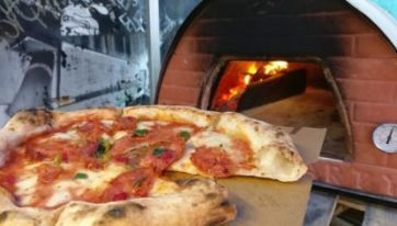 Vegans and Carnivores Alike Will Rejoice Over This Unreal New Pizza Spot