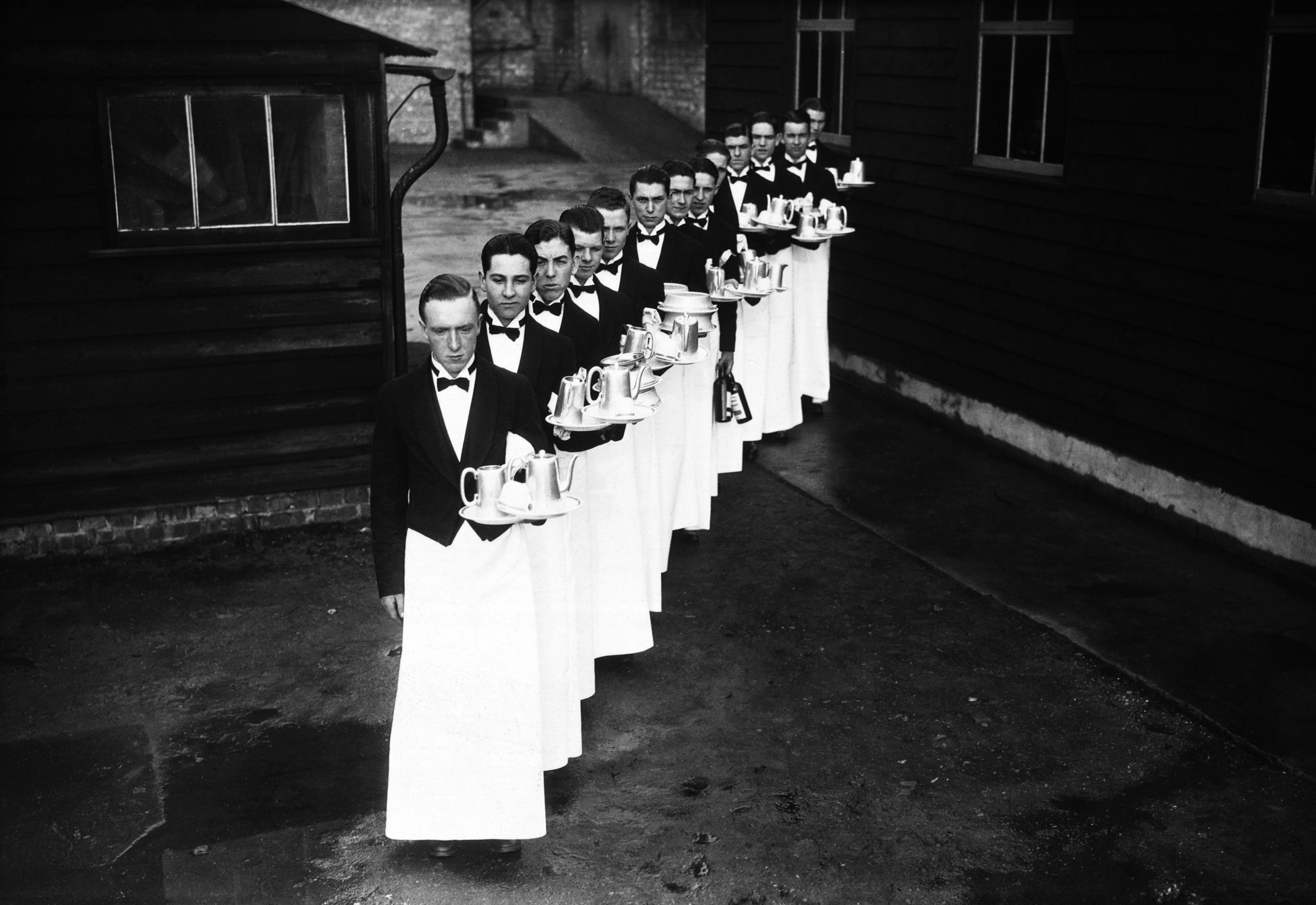 aspiring-waiters-with-their-trays-at-a-deportment-class-at-londons-school-for-waiters-1934