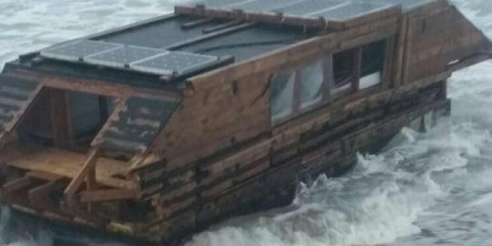 Battered houseboat washes up i...