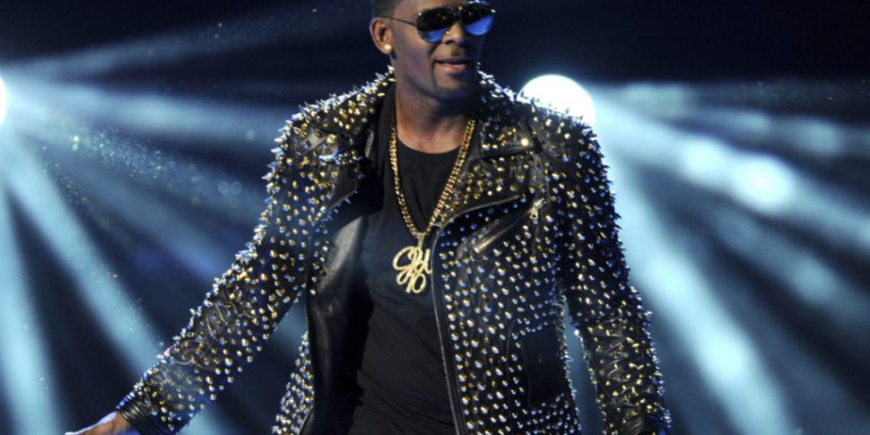 R Kelly charged with ten count...
