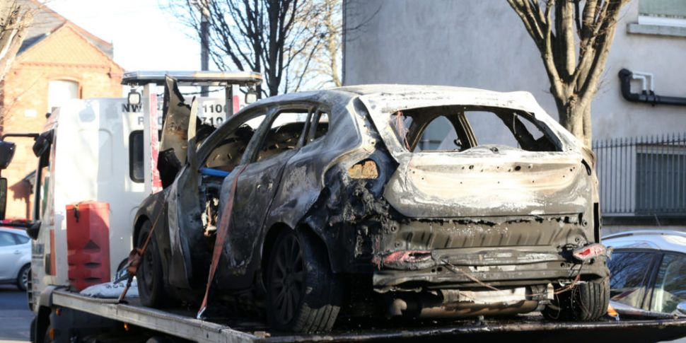 Remains in burnt-out car confi...
