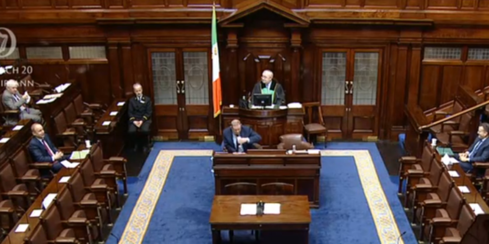 Reduced Dáil begins sitting to...