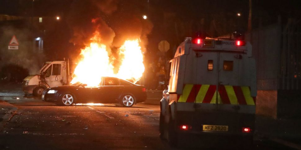 Two men charged with rioting i...