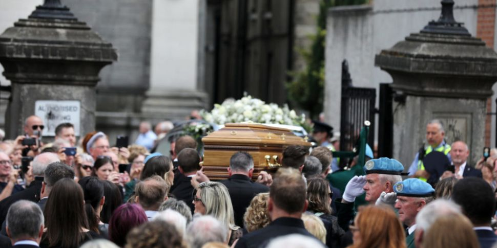 Hundreds of mourners gather in...