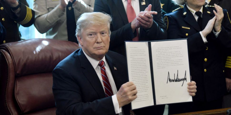 Trump issues first veto after...