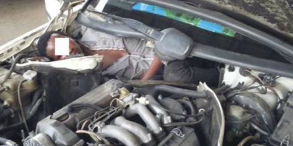 Spanish police find migrant squeezed next to car engine