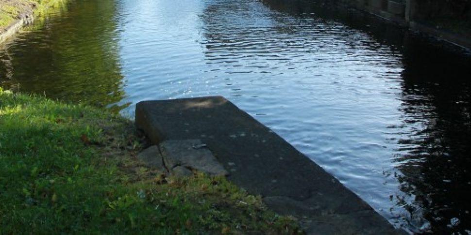Dublin canal bridge flooded to...