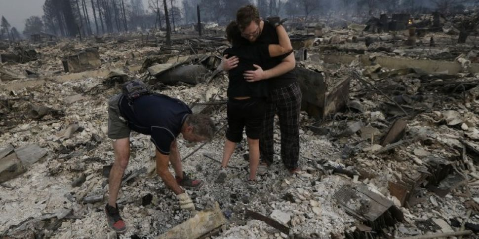 Ten dead as wildfires rage acr...