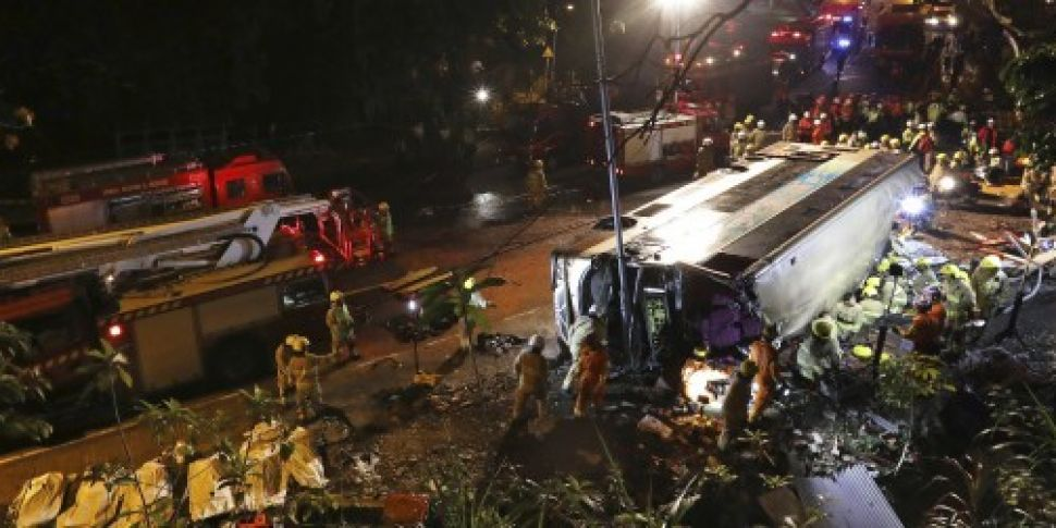 At least 18 dead after bus top...