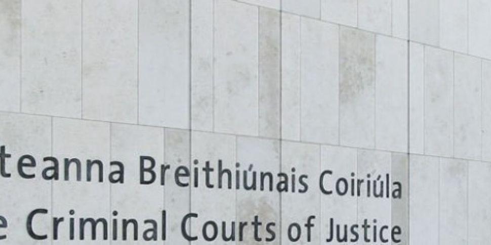 Three men appear in court in c...