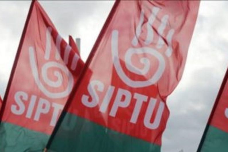 Trade union groups stage protest outside Monaghan Town constituency office of Minister Heather Humphreys