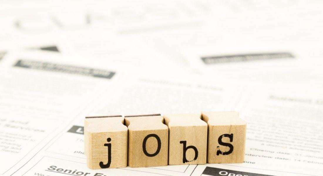 Tiles spell the word 'jobs'