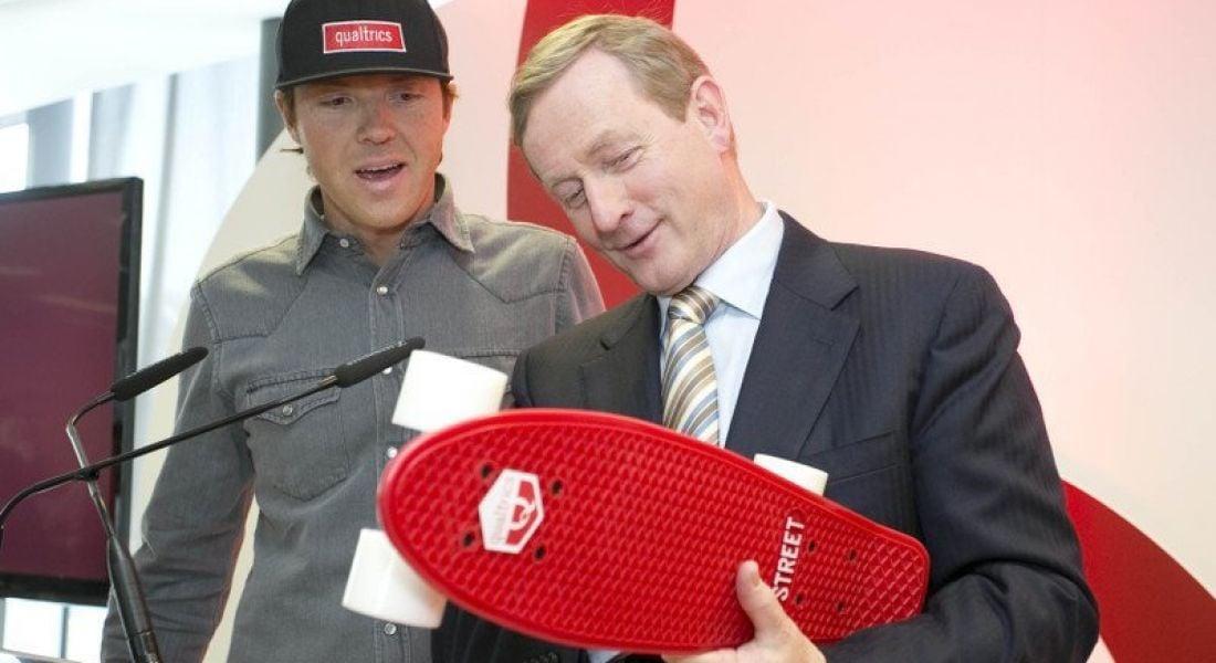 Ryan Smith CEO Qualtrics, presented Enda Kenny with a skateboard