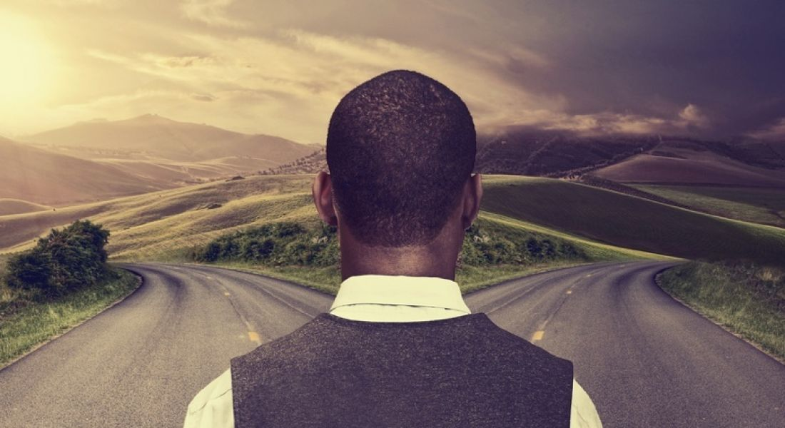 Man stands at a fork in the road