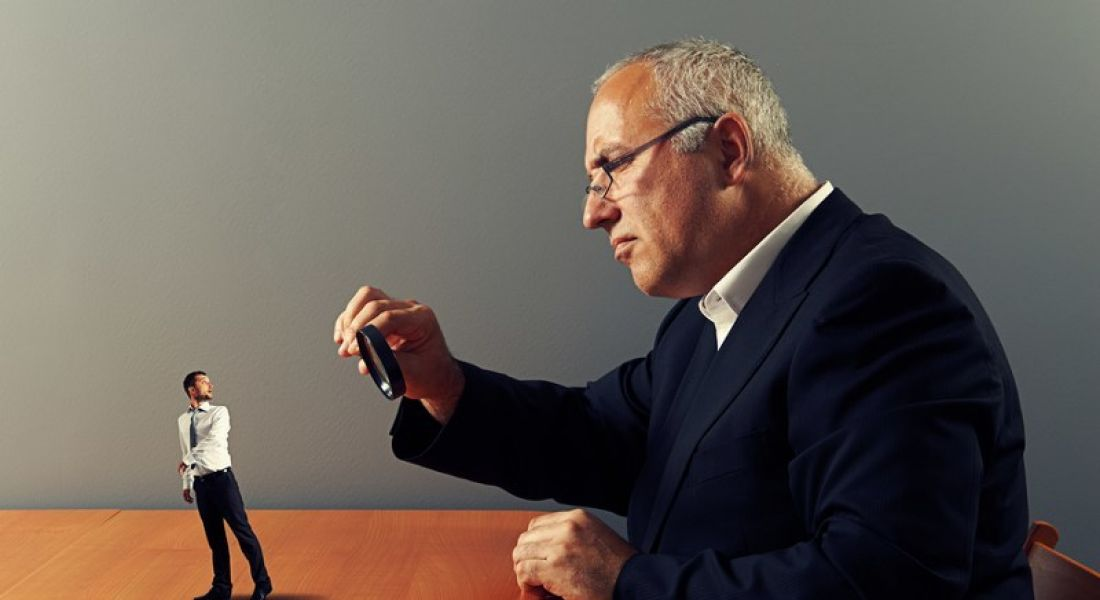 What do employers look for: Prospective employer examining candidate with magnifying glass