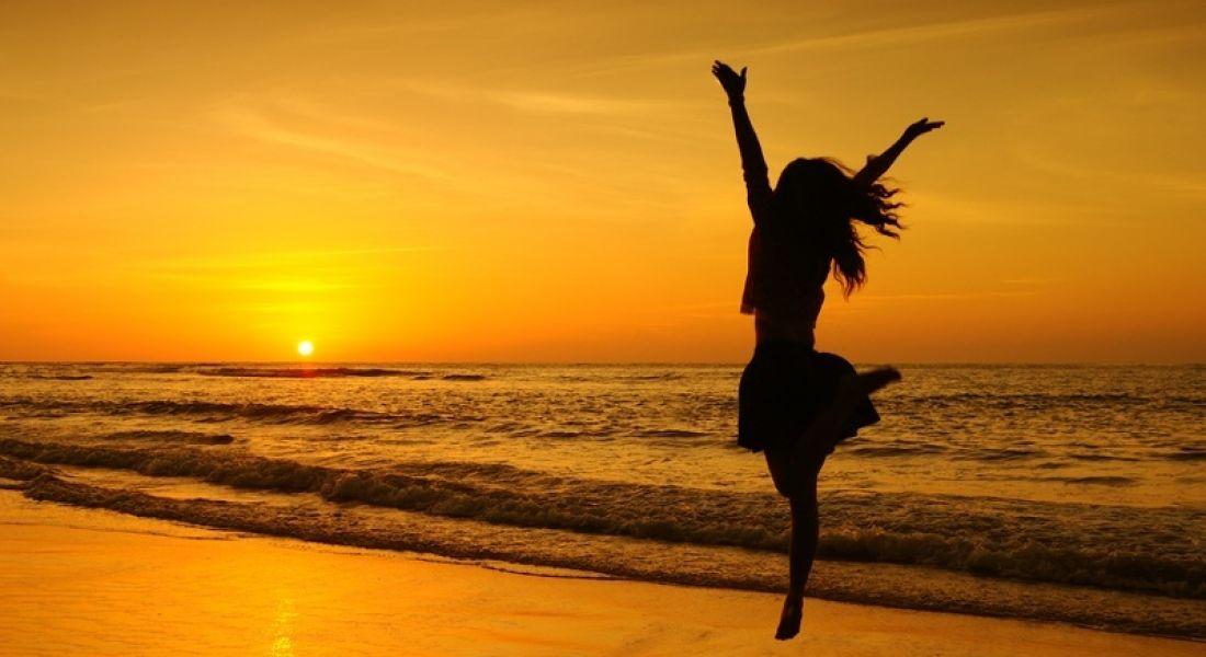 Jobs announcement: person jumping for joy, sunset, summer