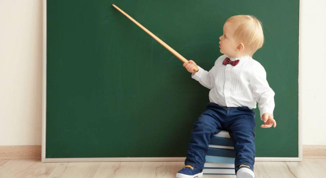 baby at blackboard