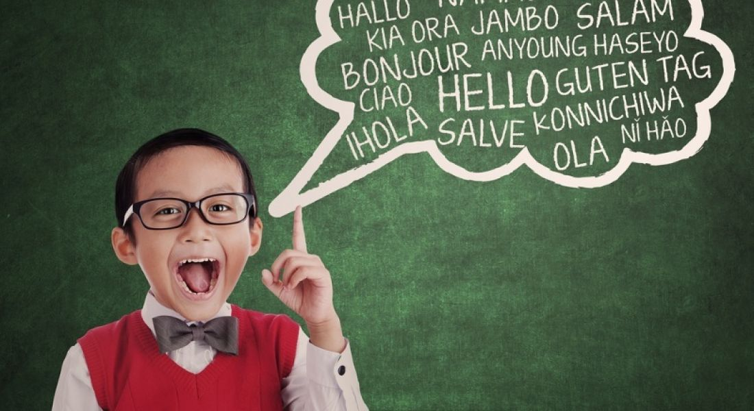Language: Young boy and multilingual speech bubble