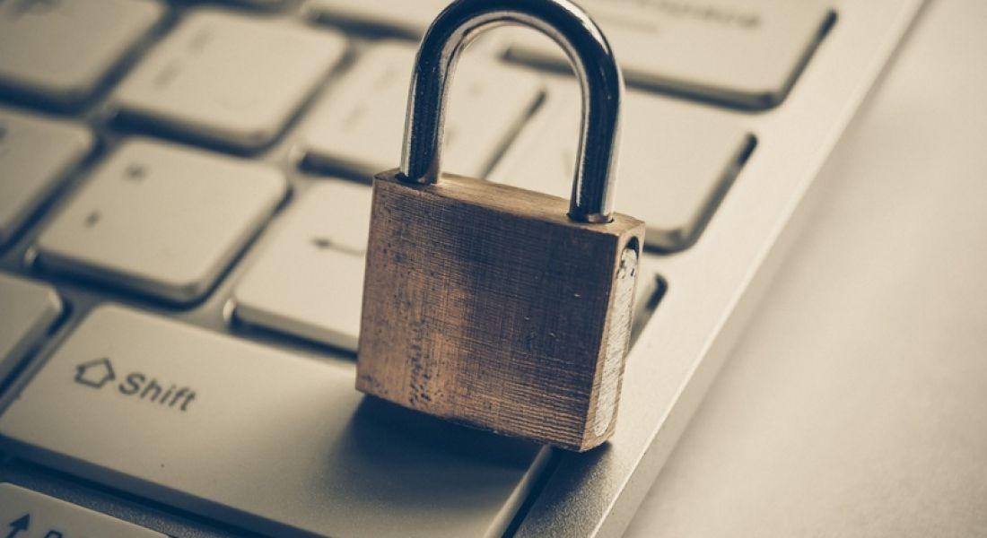 Infosec: padlock on laptop keypad