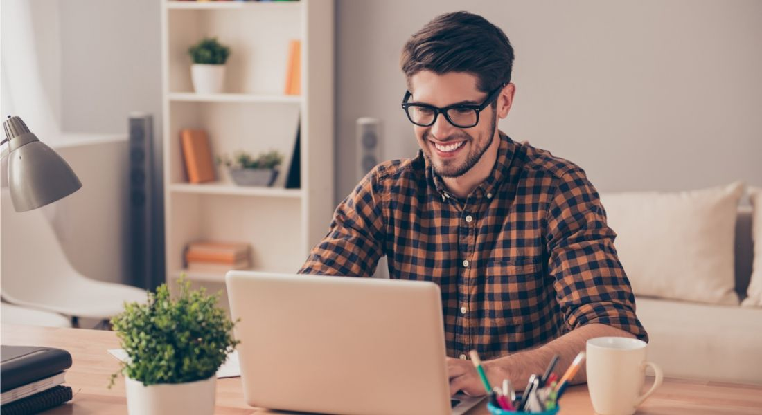 Man experiencing happiness at work