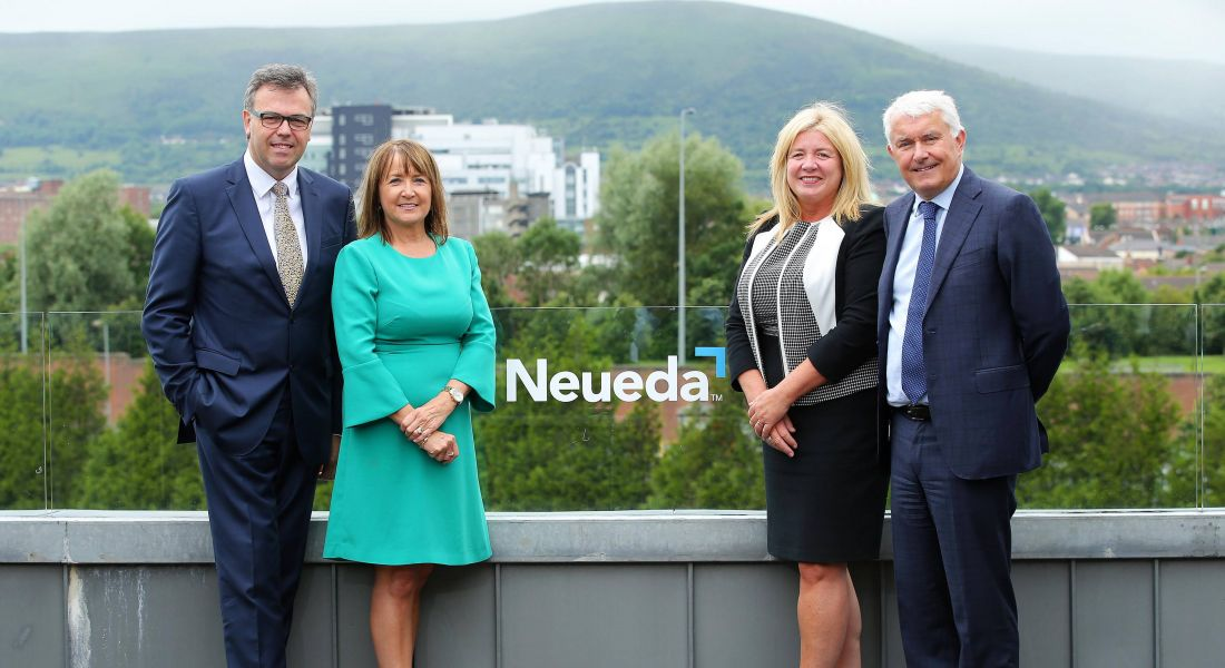 From left: Invest NI's CEO Alastair Hamilton, Ann McGregor if the NI Chamber of Commerce, Michelle Bell from the Department for the Economy, and Brendan Monaghan, CEO of Neueda. Image: Kelvin Boyes/Press Eye