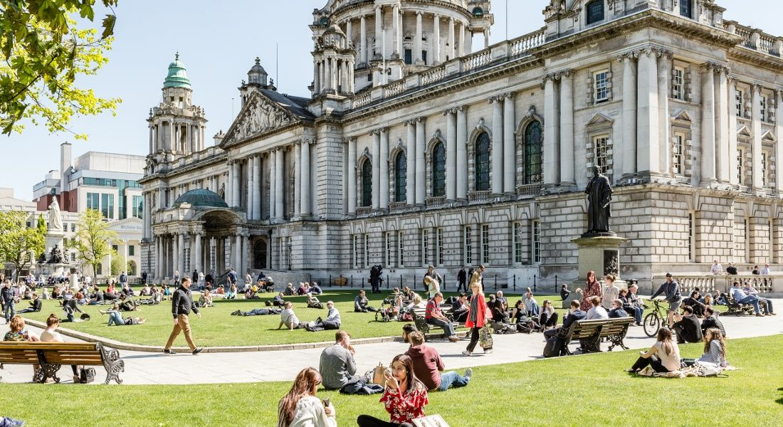 Belfast City Hall and grounds. Version 1 is building up its workforce in the city. Image: James Kennedy NI/Shutterstock