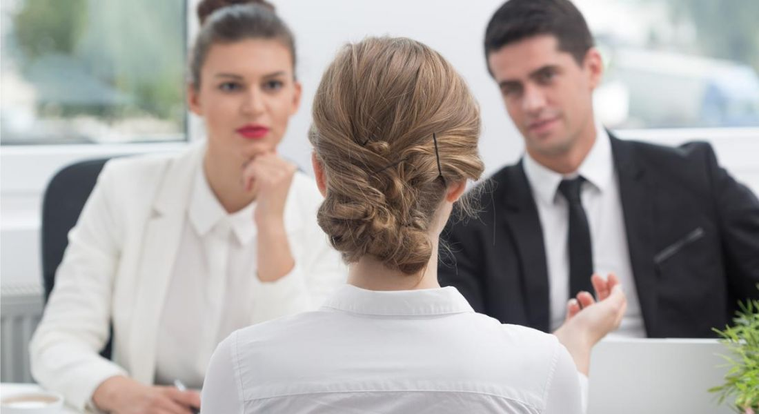 Candidate speaks to recruiters during interview