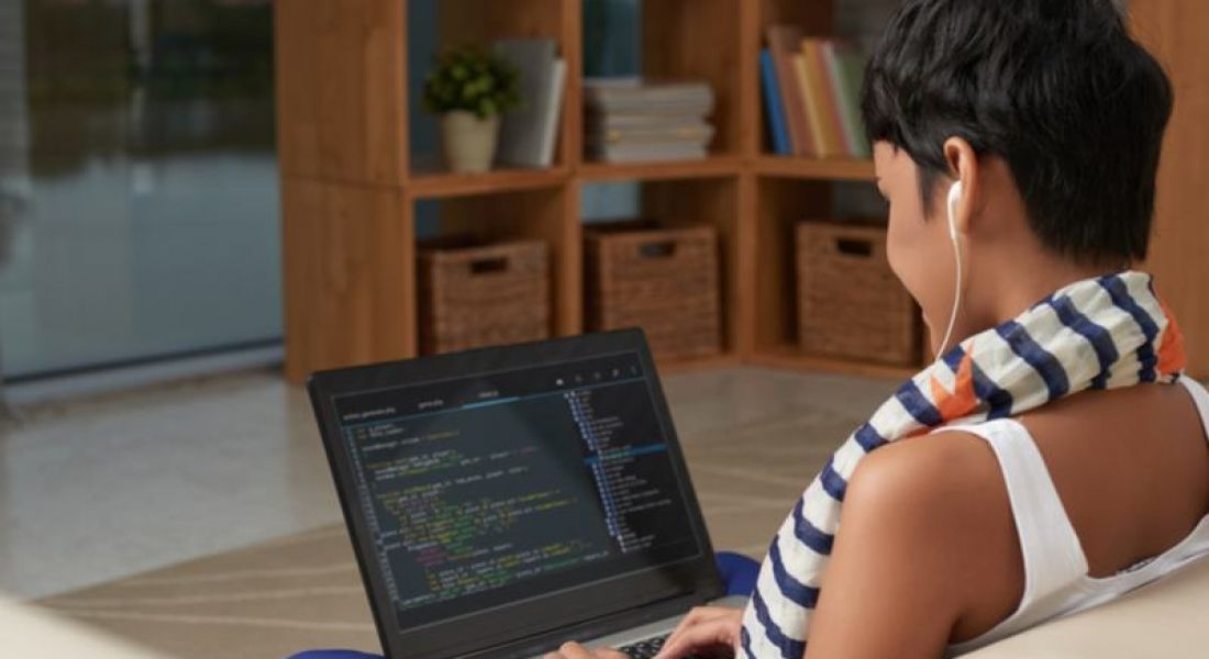 woman coding at home