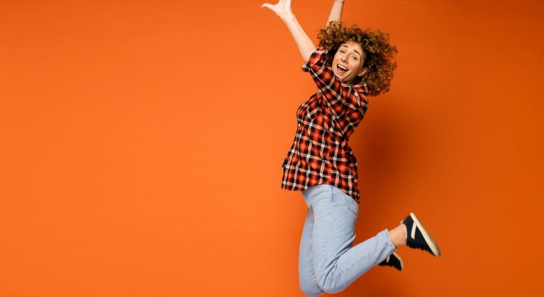 women jumping because she is excited about jobs