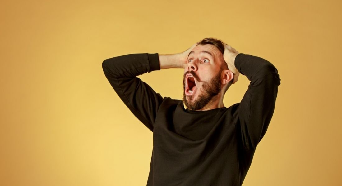 Man shocked and happy because of all the jobs announced against a yellow background