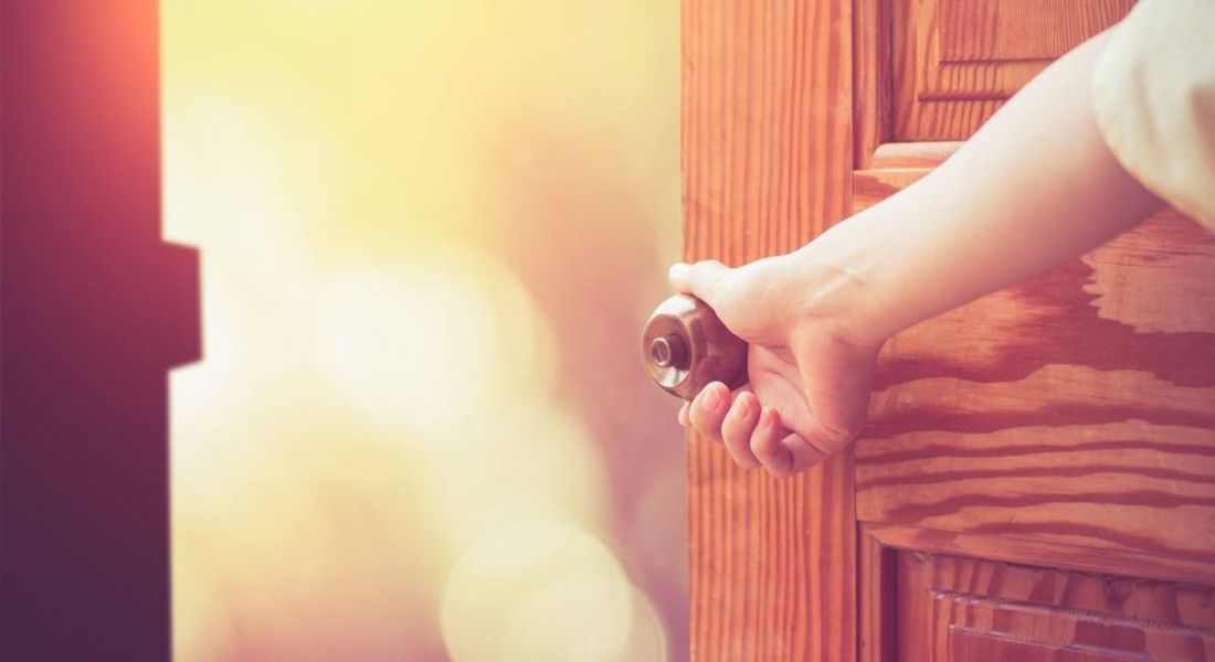 Woman's hand opening a door. Accessibility to world of work Specialisterne, Pete Brabazon