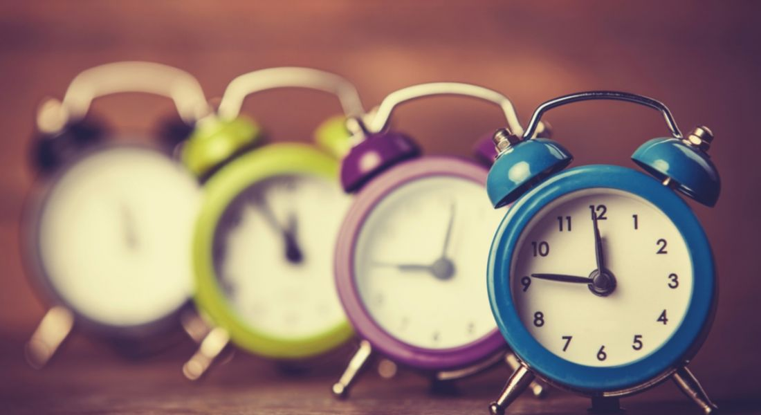 Four colourful clocks in varying degrees of focus to show the concept of learning to leave work on time